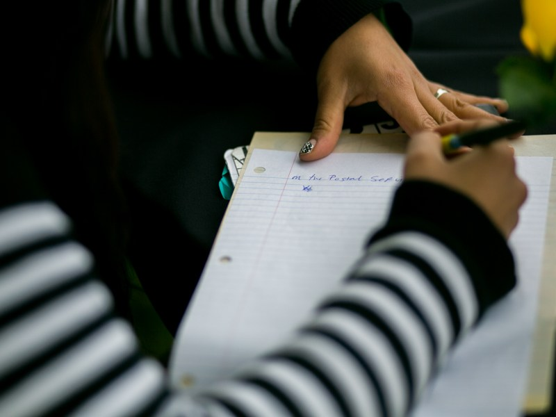 Amanda Flores works on a short story during a creative writing workshop at Mission Marquee Plaza.