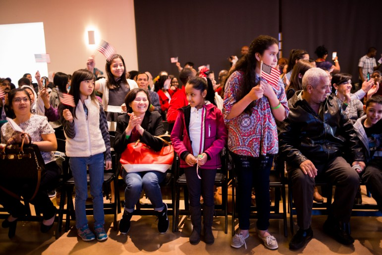 Families celebrate as the children are awarded U.S. naturalization.