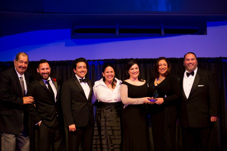 The OCI Group accepts the Business Category Texas Star Heritage Award.