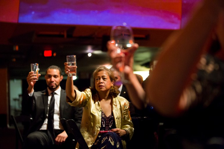 Attendees raise a glass in toast to UTSA President Dr. Ricardo Romo.