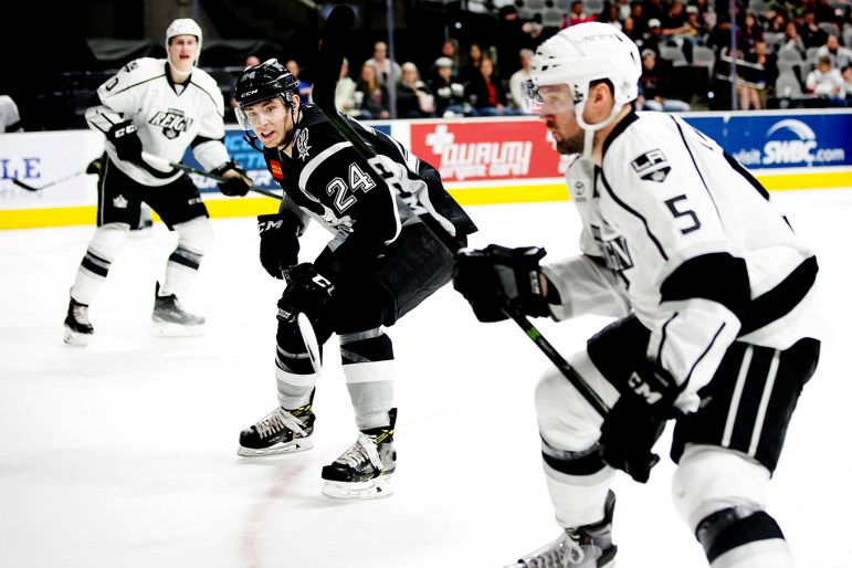 San Antonio Rampage forward A.J. Greer, 24, works to keep the puck away from Ontario Reign players.