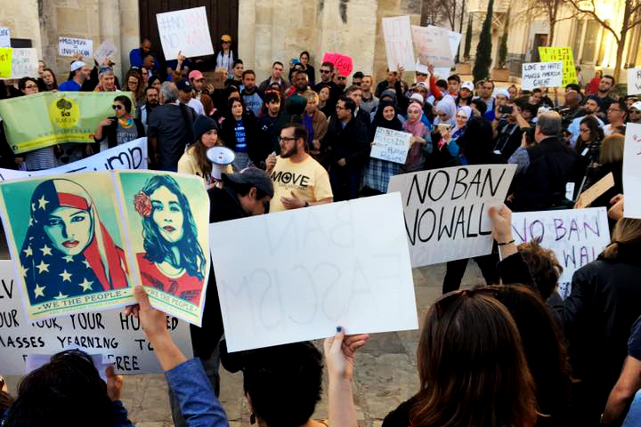 Protestors gather in Main Plaza on Sunday, Jan. 29, to protest Trump's temporary immigration ban.