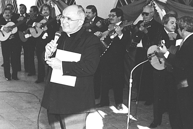 Archbishop Flores at a speaking engagement backed by a mariachi.