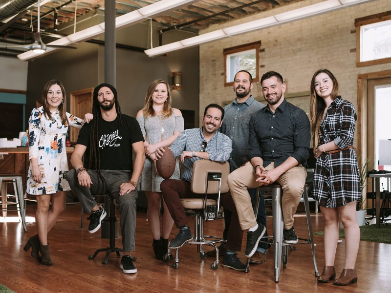 The Chamoy Creative team stand for a photo in their offices on South Flores.