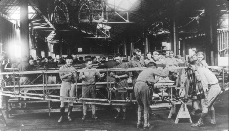 Enlisted mechanics at Kelly Field assemble a plane's fuselage, October 1918.