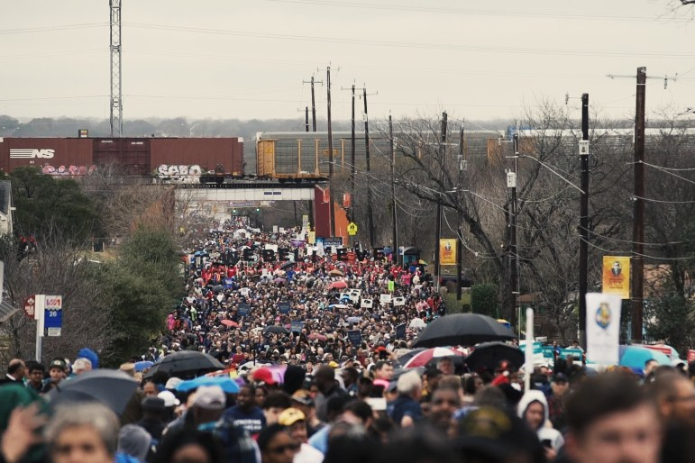 Thousands of people march up MLK Drive as part of the 2.75-mile 2017 MLK March.