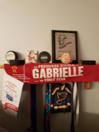 A.J. Greer kept the badge with Gabrielle's name on it in his hockey bag for years.