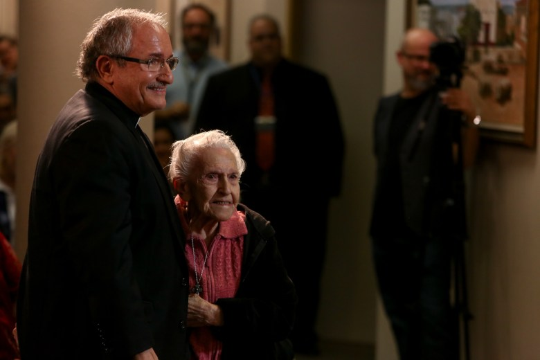Auxiliary Bishop-elect Michael Joseph Boulette and his 96 year old mother, Pat Boulette, direct their attention to Archbishop Gustavo García-Siller.