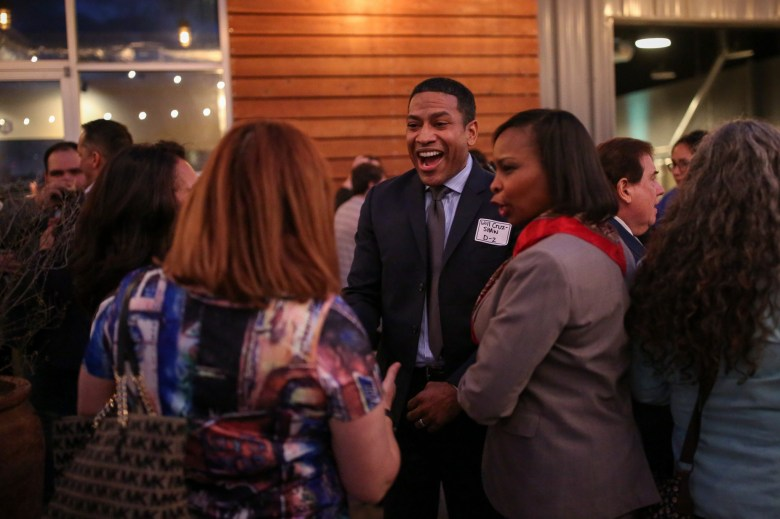 """District 2 candidate William """"Cruz"""" Shaw laughs with attendees and Mayor Ivy Taylor."""