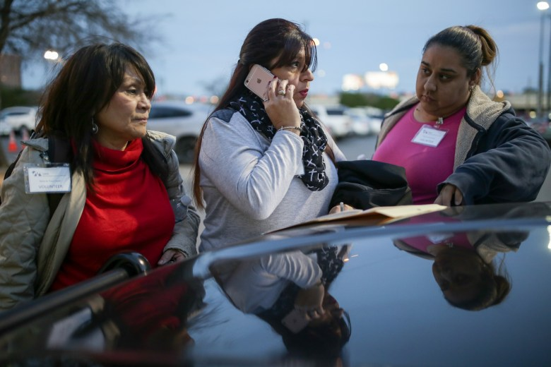 (left to right) Volunteers Irene Guzman, Cynthia Aleman, and Sarah Hernandez call to find out exactly where they need to be for the Point in Time count.