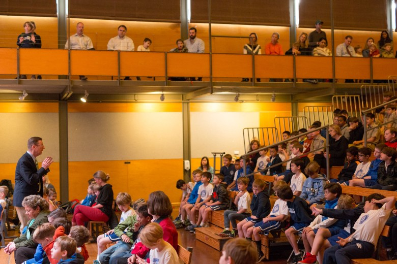 Head of School John Webster gives his morning chapel presentation to the entire student body at San Antonio Academy.