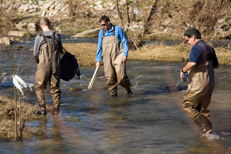 San Antonio River Authority Aquatic Biologists (left to right) Chris Vaughn, Shaun Donovan, and Larry Larralde perform specific duties before searching for mussels.