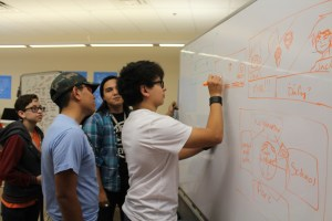 """A team of SAY Sí students storyboard scenes for the """"Date Me Super Senpai"""" game."""