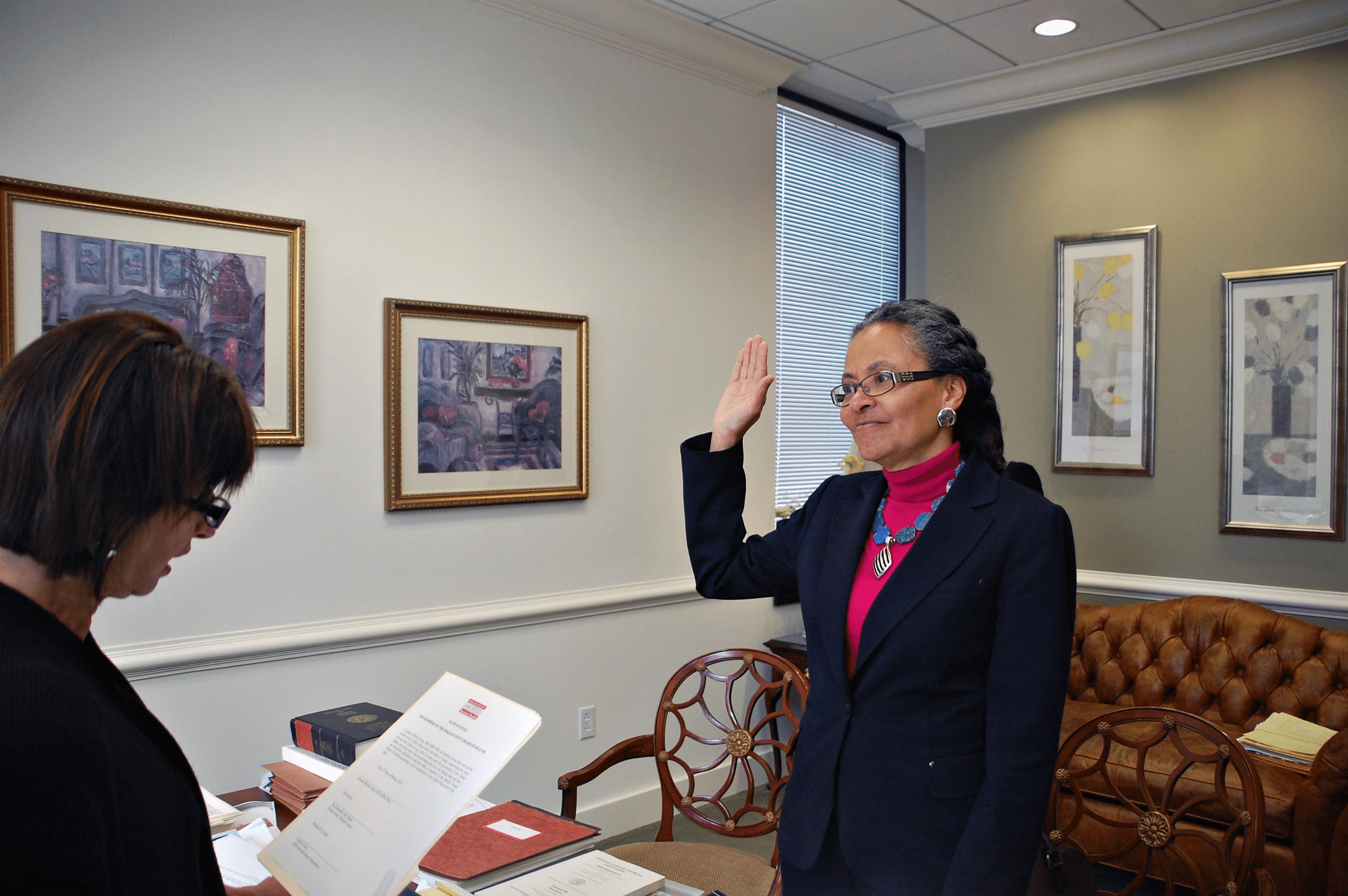 Dr. Camara Jones is sworn in as a member of the DeKalb County Board of Health.