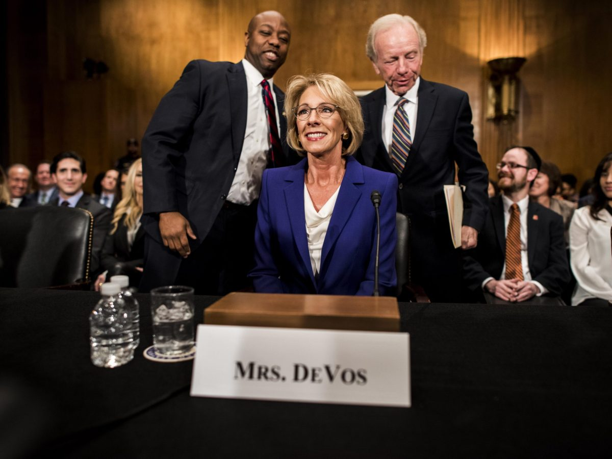 Accompanied by Senator Tim Scott (R-SC) and former Senator Joe Lieberman, President-elect Donald Trump's nominee for Secretary of the Education Betsy DeVos appears before the Senate Health, Education, Labor and Pensions Committee for her confirmation hearing on Capitol Hill in Washington, DC Tuesday January 17, 2017.