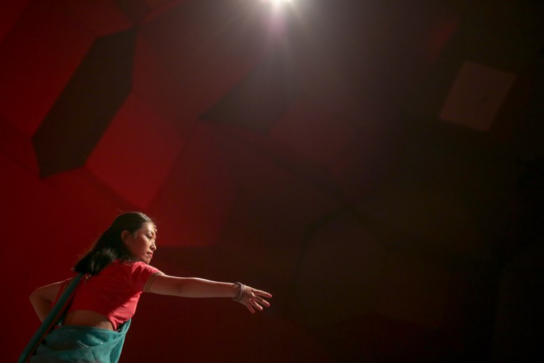 A member of the University of the Incarnate Word Asian Culture Club dances to hundreds of viewers.