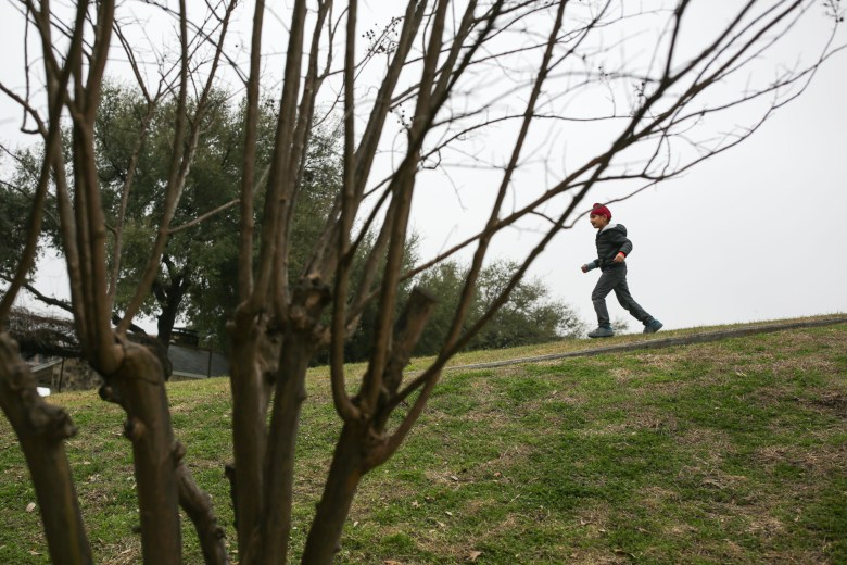 Veeraj, 6, runs down the hill chasing after friends and family on the ITC grounds.