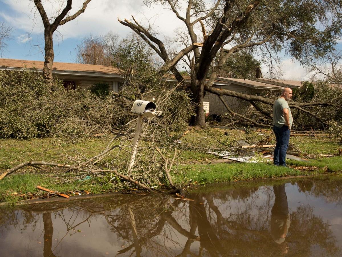 Homeowner Michael Ovalle surveys the damage taken to his block.
