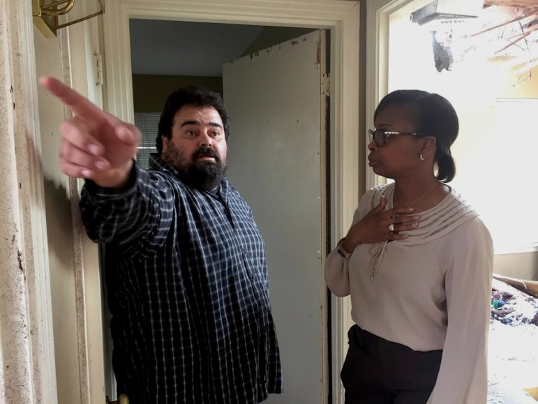 Mayor Ivy Taylor speaks with homeowner Adrian Venegas as he surveys the damage done to his home after a tornado swept through his neighborhood.