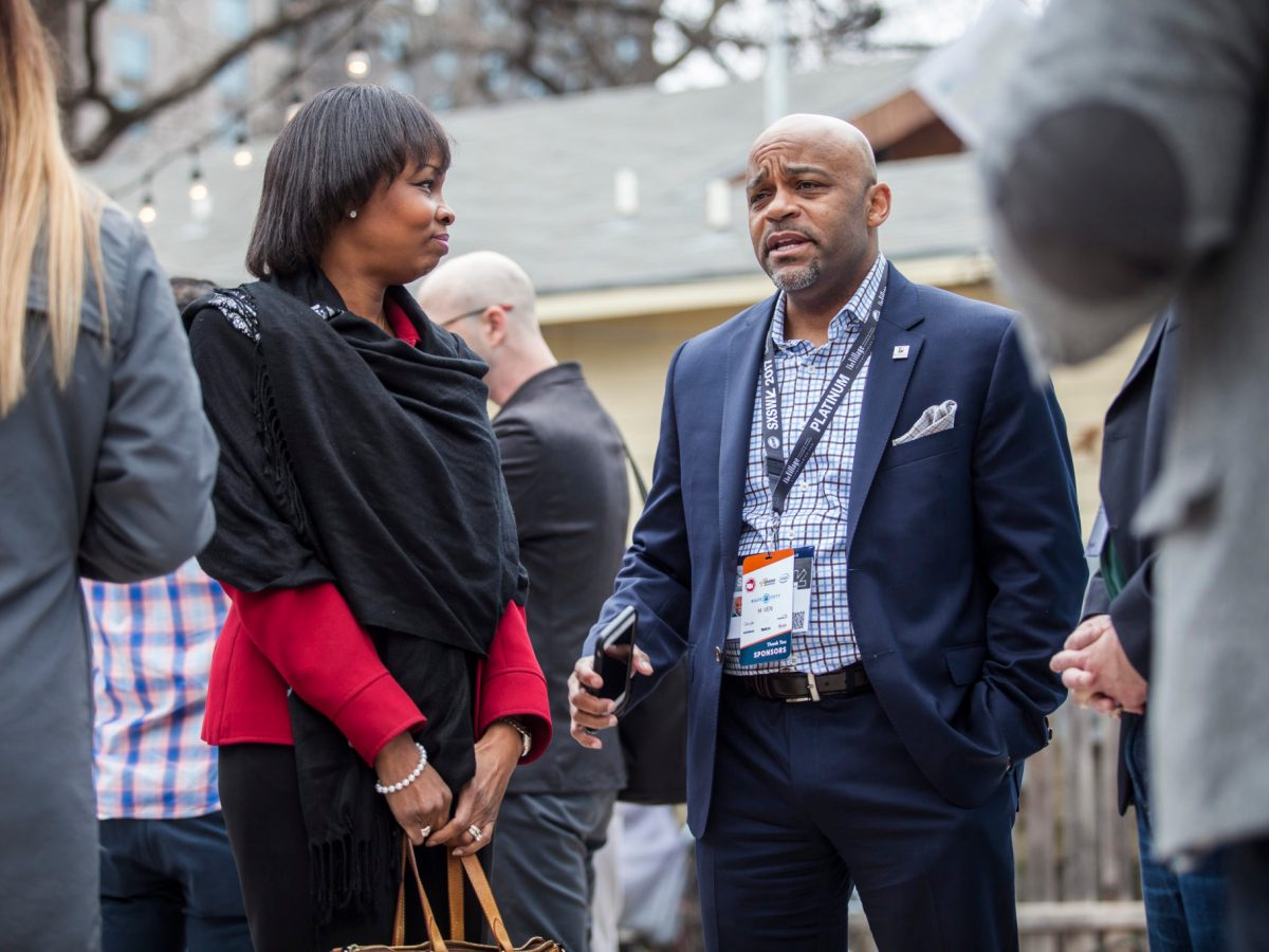 Mayor of San Antonio, Texas, Ivy Taylor, left, talks to Mayor of Denver, Colo., Michael Hancock, right, during the South by South West ChooseSA event, on Sunday, March 12, 2017 at the Half Step Bar, in Austin, Texas.