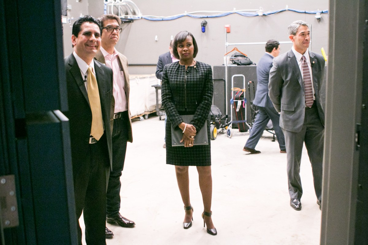 Mayoral Candidates, from left, Chairman Manuel Medina, Mayor Ivy Taylor, and Councilman Councilman Ron Nirenberg gather before the San Antonio Mayoral Debate on March 2.