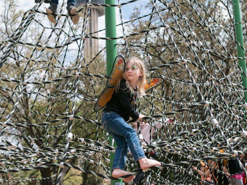 """Lucy, 4, explores the playground in her butterfly wings at the """"Monarchs, Milkweed and Migration"""" event at Hemisfair Park on March 3."""