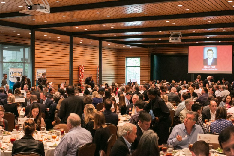 A large crowd gathers to view Urban3 Principal Joe Minicozzi's presentation at the Centro San Antonio Luncheon at the Briscoe Western Art Museum.