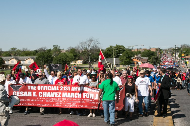 A large crowd marches down Guadalupe St. during the Official 21st Anniversary Cesar E. Chavez March For Justice.