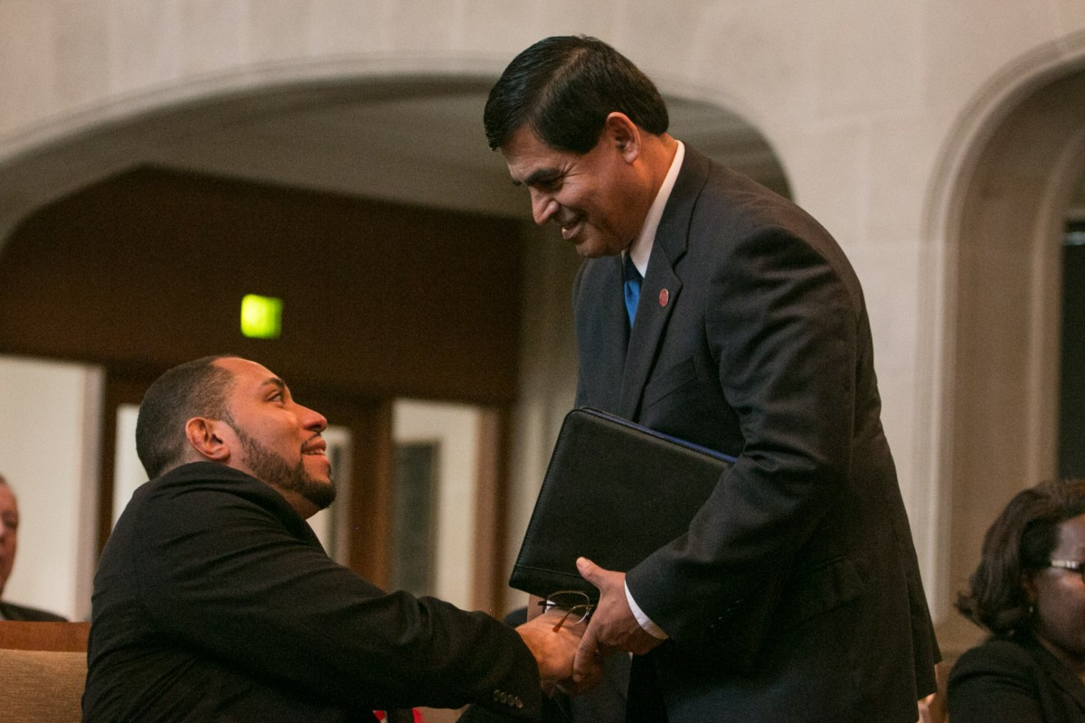 Converse Mayor Al Suarez shakes hands with Bexar County Commissioner Tommy Calvert (Pct. 4)