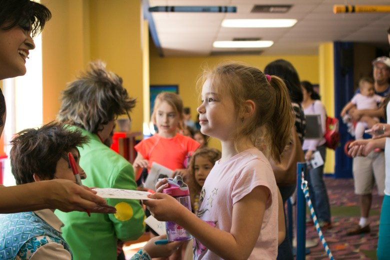 """Sophie, 7, asks for an autograph by Magik Theatre actress Jovi Lee after the sensory-friendly performance of """"The Three Javelinas."""""""