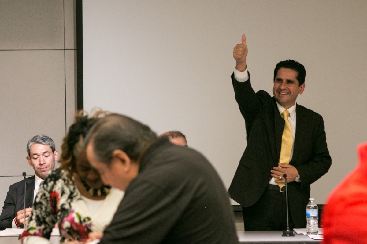 Mayoral candidate Manuel Medina sticks his thumb up in agreement to the crowd before participating in the Mayoral Arts Forum in the San Antonio Central Library auditorium.