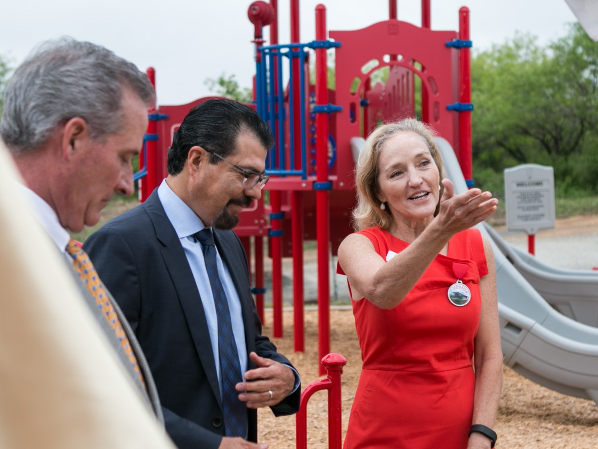 (From right) San Antonio Public Library Foundation President Tracey Bennett, San Antonio Public Library Foundation Library Director Ramiro S. Salazar, and Kingdom for Kids program founder Rick Cavender unveil the new playground of the Schaefer Branch Library.