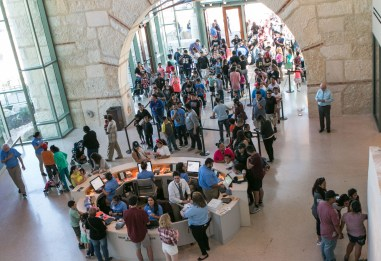 A large crowd explores the exhibits inside the Witte Museum.
