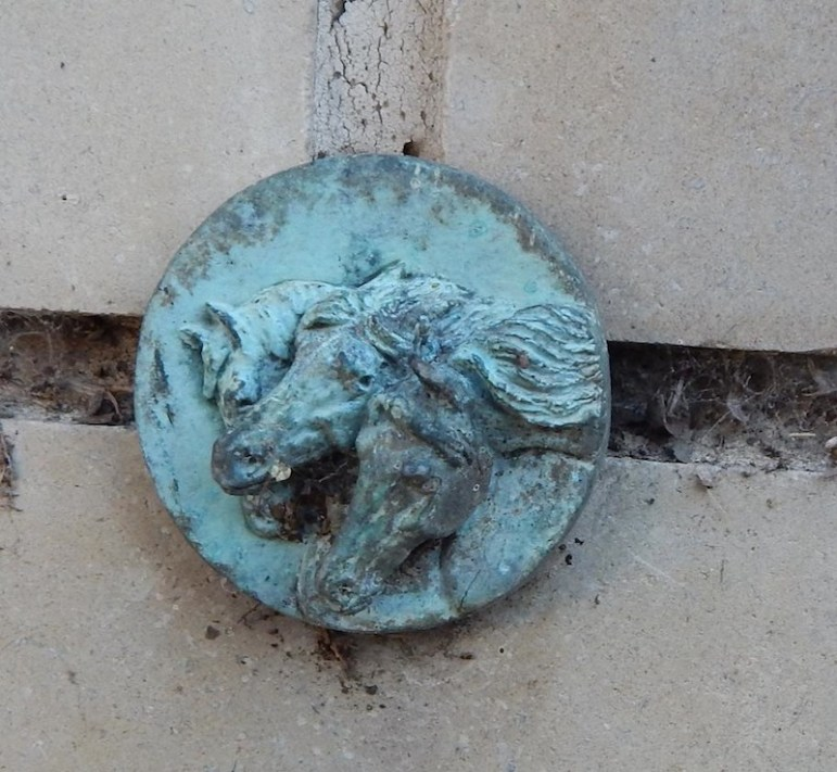 "These small bronze medallions, ""Pharaoh's Horses,"" decorated the Frost Motor Bank Wall."