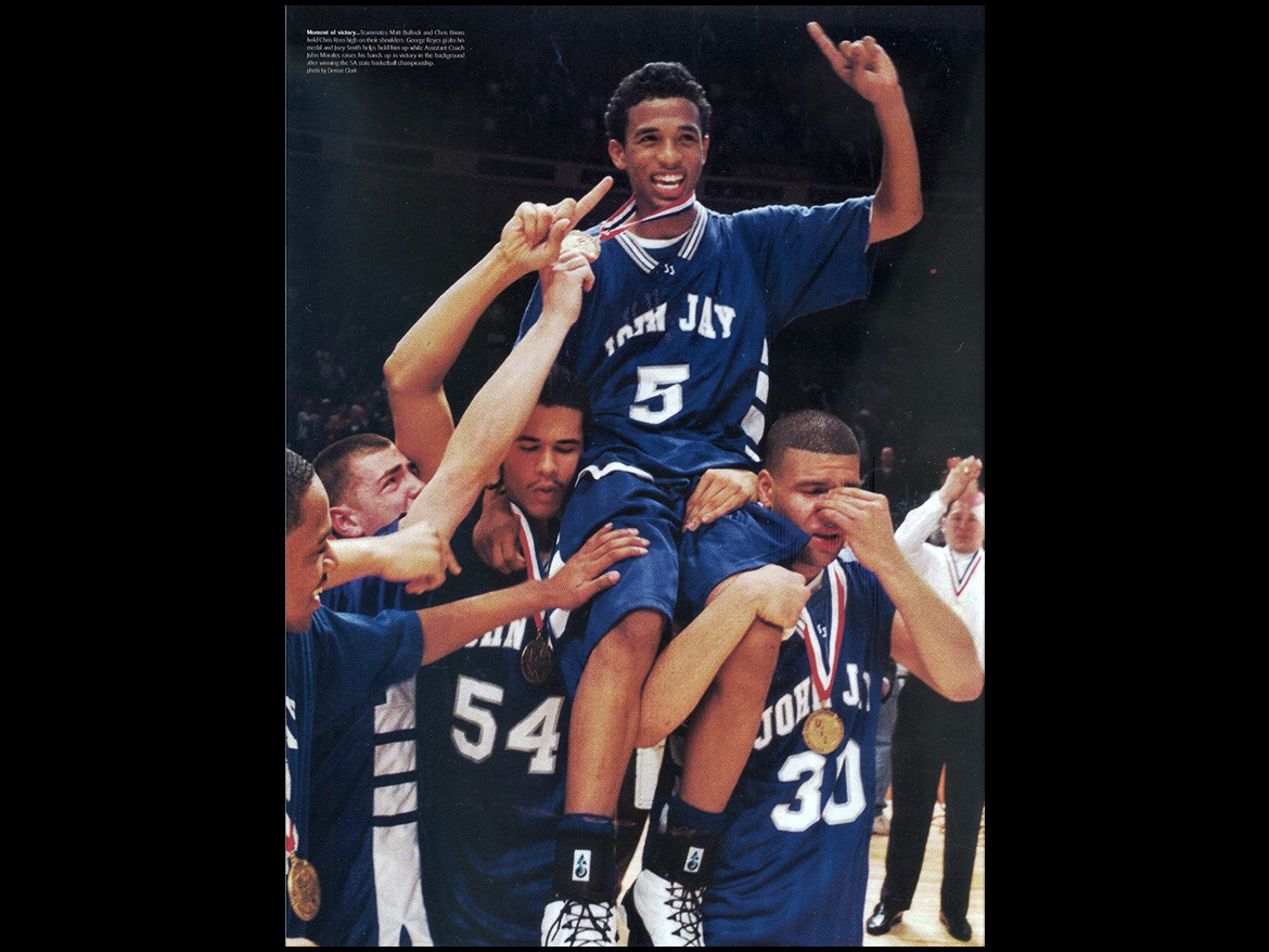 John Jay Senior Chris Ross is hoisted on his teammates shoulders following a game winning half-court shot at the High School State Championship in 2002.