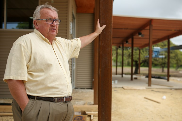 Municipal Golf Association – San Antonio President and CEO Jim Roscheck looks out over the renovated golf range from the clubhouse, which is also under construction.