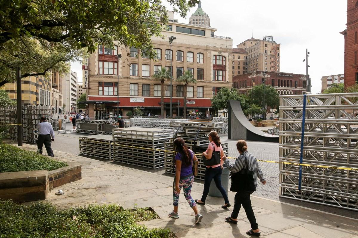 Pedestrians walk along Dolorosa street at Main Plaza as America Ninja Warrior stage preparations begin.