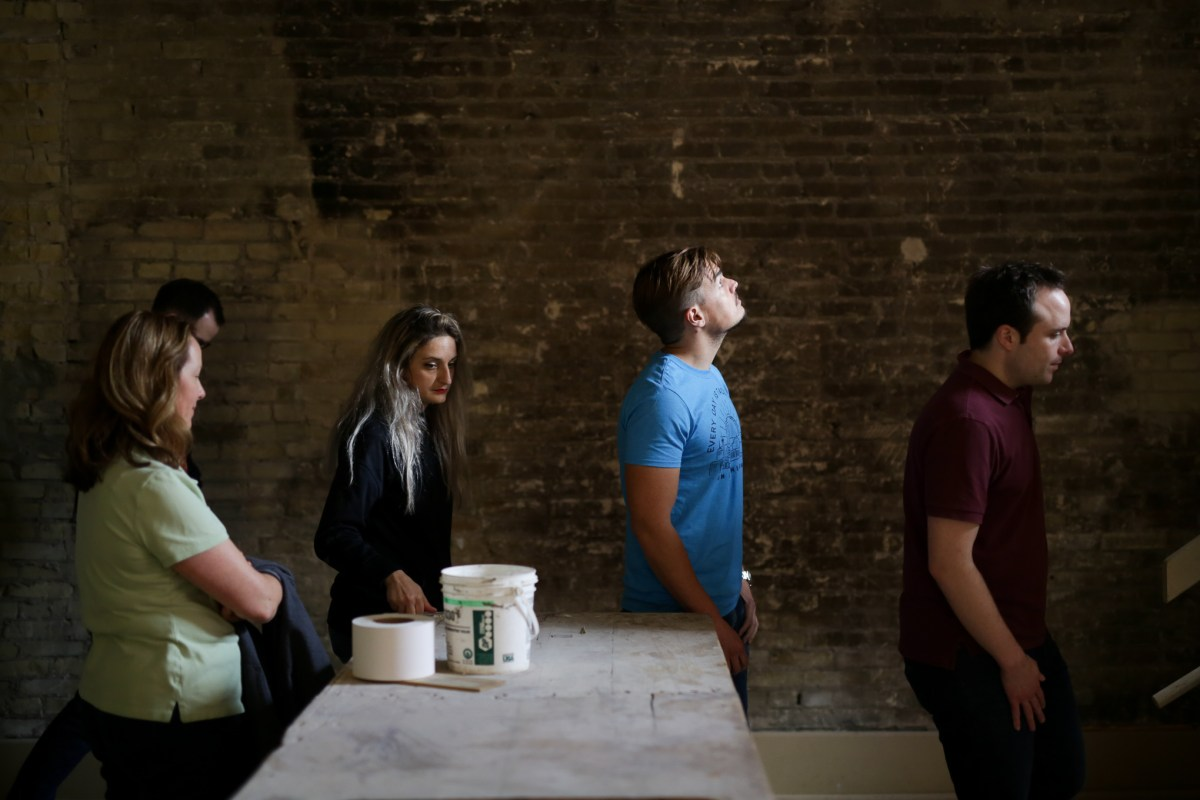 Scaleworks employees tour the Savoy building, which is currently undergoing renovations.