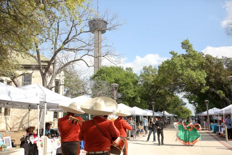 Local vendors ans organizations line East Nueva Street for the celebration.
