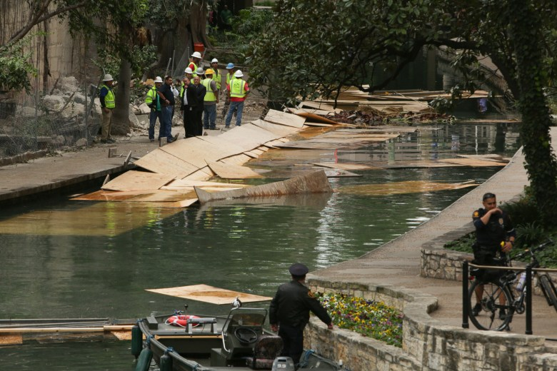 Debris from the Solo Serve construction site fell into the San Antonio River and Riverwalk.