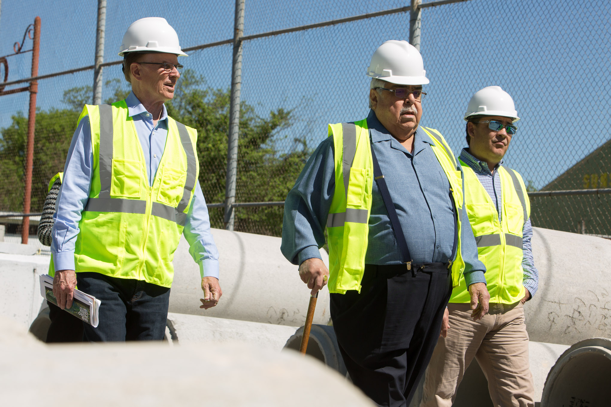 (From left) Bexar County Judge Nelson Wolff and County Commissioner Paul Elizondo (Pct.2) tour phase one of the San Pedro Creek project.
