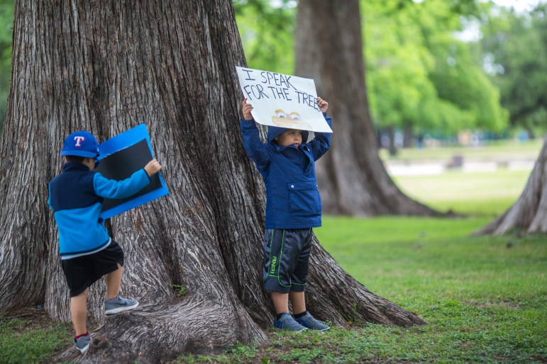 Elijah Tyler Martinez, 5, (right) stands next to his brother Connor, 4, as they protest at San Pedro Park.