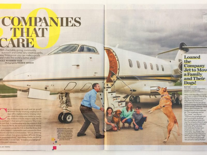 NuStar's Health, Safety, and Environmental Executive Director Christ Butler with his family and dogs outside the NuStar company jet.