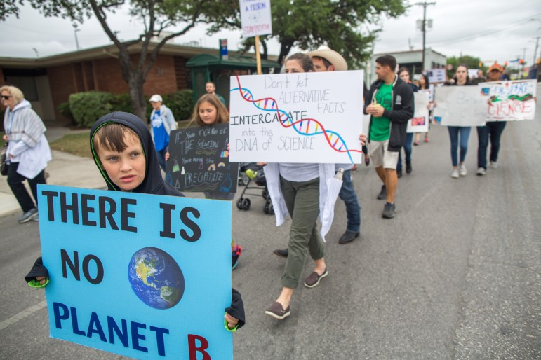 Participants march down Ashby Street.