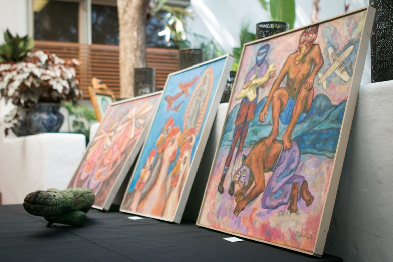 Paintings of the late José Guadiana are displayed at the tribute to Alicia Guadiana.