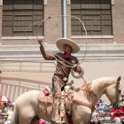 A charro shows some tricks with his lasso during the Battle of Flowers Parade.