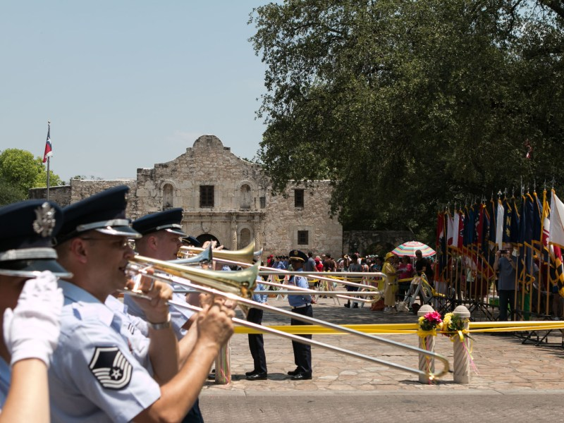 The Battle of Flowers Parade passes in front of the Alamo.