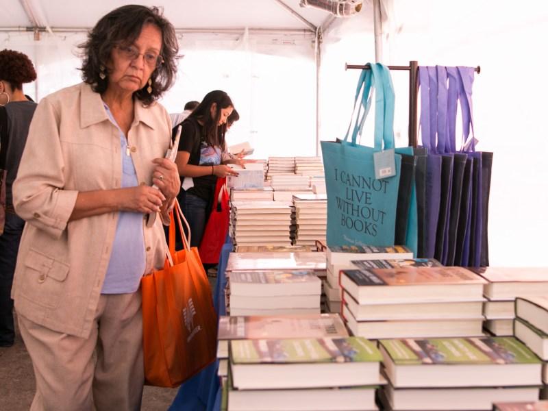Irma Mireles explores the Barnes & Noble tent at the San Antonio Book Festival.