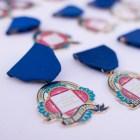 San Antonio Public Library Foundation fiesta medals are on display at the San Antonio Book Festival.