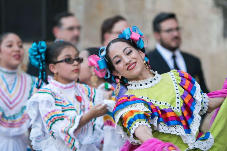 Dancers greet the crowd before the crowning of El 69th Rey Feo Fred Reyes.